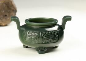 史前遗珍鉴藏:良渚玉器上面目狰狞的神徽